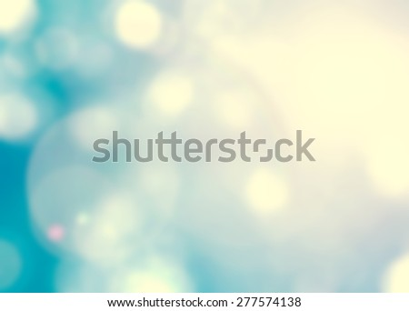 Vintage color tone blurred nature background of a view looking up through the foliage of a tree against the sky facing sun flare and bokeh - stock photo