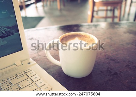 vintage color tone of  cup of coffee  on the table coffee shop - stock photo
