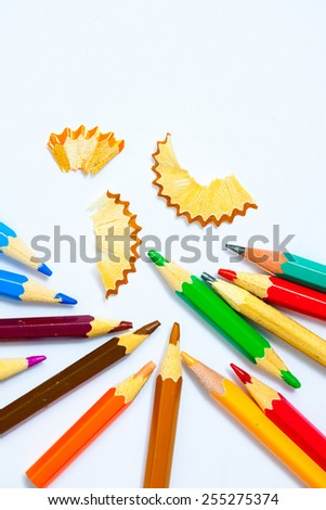 vintage colored pencils with chips on white background - stock photo