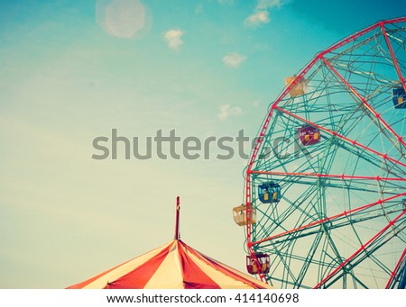 Vintage colorful ferris wheel over blue sky - stock photo