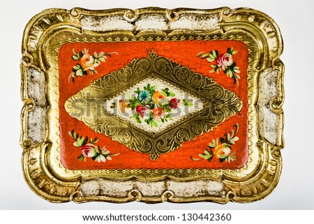 Vintage colorful painted tray - closeup isolated on white background - stock photo
