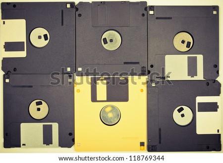 Vintage colors diskettes background. Six floppy disks - stock photo