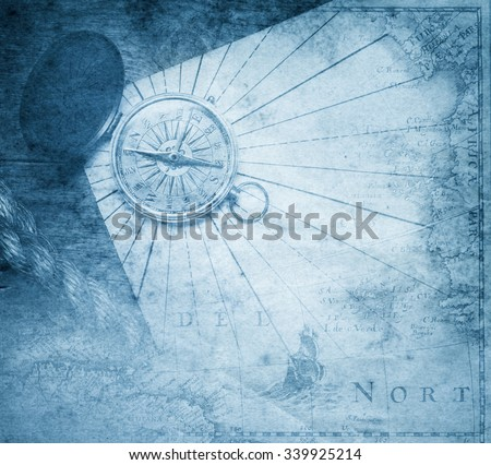 Vintage  compass with nautical map background. - stock photo