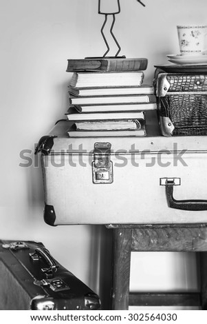 Vintage composition of old suitcases, stools and books. Black an - stock photo