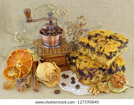 Vintage composition with pieces of pie and coffee grinder - stock photo