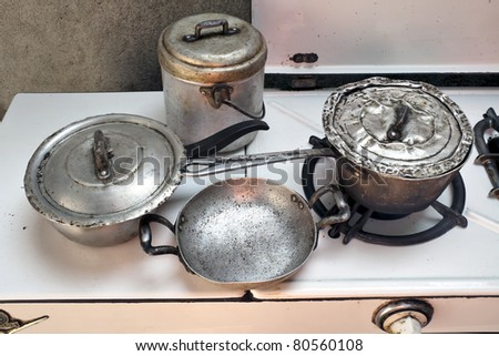 vintage cooker with old pots - stock photo