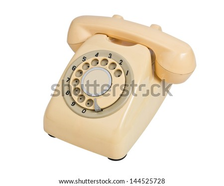 vintage cream telephone isolated over white background