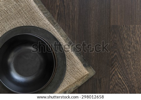Vintage crockery bowls on rustic wooden background - stock photo