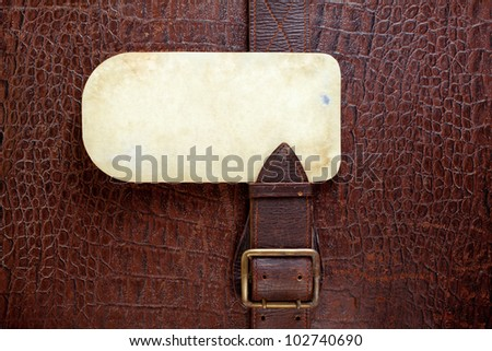 Vintage crocodile leather textured background with old paper blank - stock photo