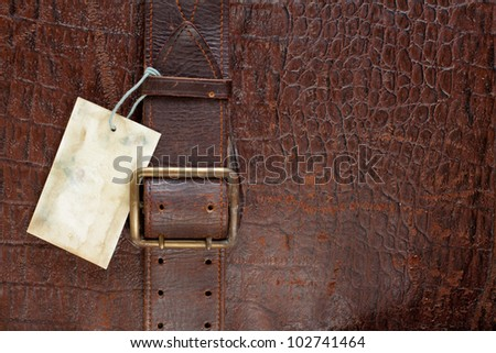 Vintage crocodile leather textured background with price tag blank - stock photo