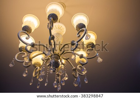 Vintage crystal chandelier in the foyer - Lamp with warm light