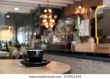 Vintage cup of coffee on table in cafe - stock photo