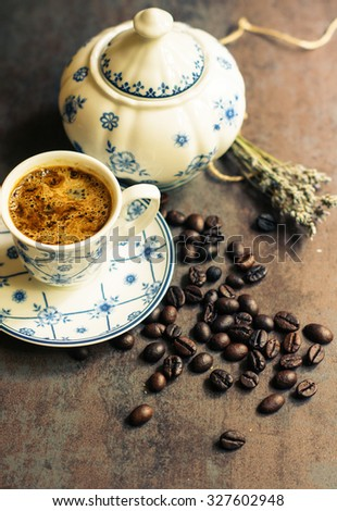 Vintage cup with black coffee, dry lavender flowers and coffee beans. Toned picture - stock photo