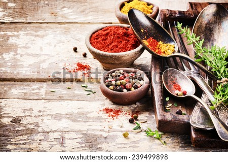 Vintage cutlery and colorful mix of spices - stock photo