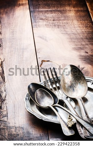 Vintage cutlery on wooden table  - stock photo