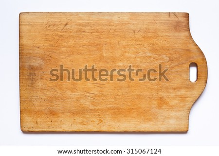 Vintage cutting board, well used, with a lot of cuts and scratches on white background, copy space - stock photo