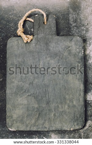 vintage cutting board with space for text on old marble background, close-up - stock photo