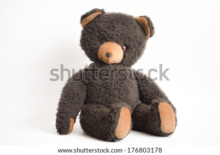 Vintage Dark brown Teddy Bear. Isolated on white background. - stock photo