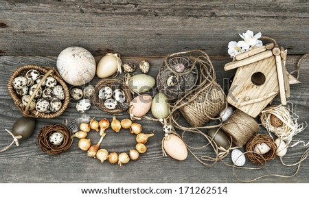 vintage decoration with eggs and flower bulbs. nostalgic easter still life home interior. wooden background . selective focus, dark designed - stock photo