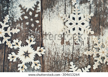 Vintage Decorative Snowflakes on Wooden Old Background, Decorated with Ising Sugar - stock photo