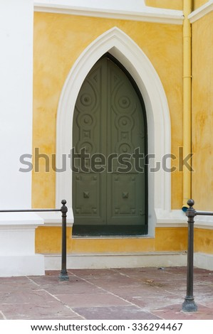 vintage doors and yellow wall background