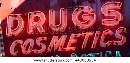 vintage drugs and cosmetics neon sign - stock photo