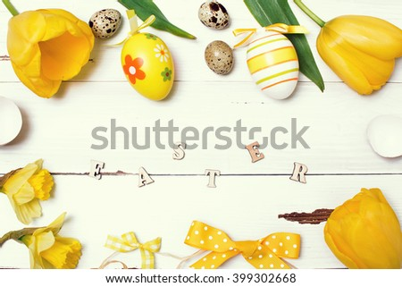 Vintage easter background with eggs and flowers. - stock photo