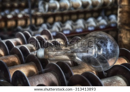 Vintage Edison Light Bulb Sitting on Wooden Spools in an Abandoned Silk Mill in Lonaconing, Maryland