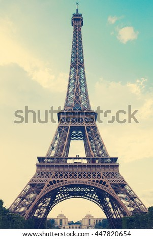 Vintage Eiffel Tower over blue sky - stock photo