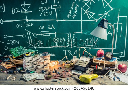Vintage electronics workplace in physics lab - stock photo