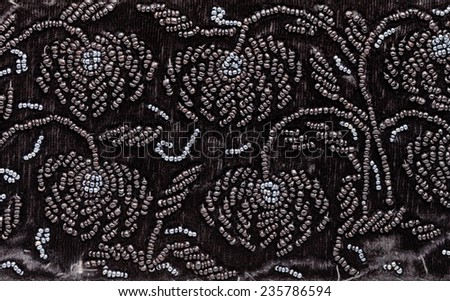 vintage embroidery by black beads on black velvet close up - stock photo