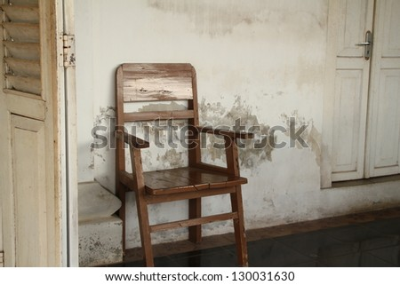 Vintage Empty Chair On a Wooden Deck