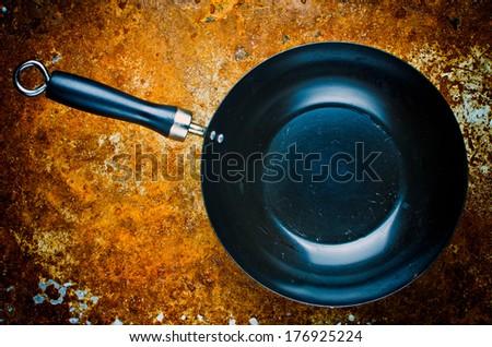 Vintage empty wok pan - stock photo