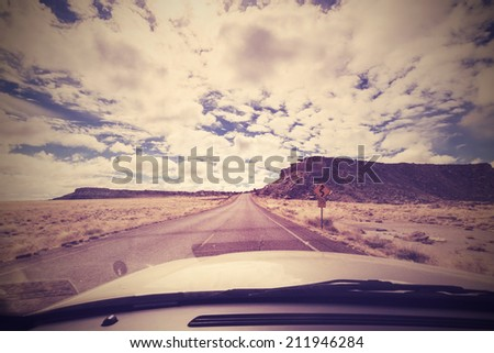 Vintage endless road, photo taken from front seat of a car, USA. - stock photo