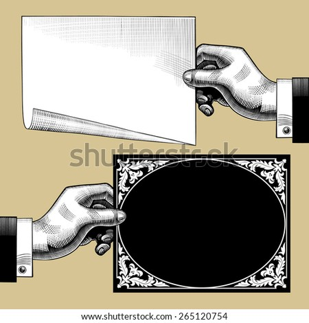 Vintage engraving drawing of hands with paper and old decorative framed signboard - stock photo
