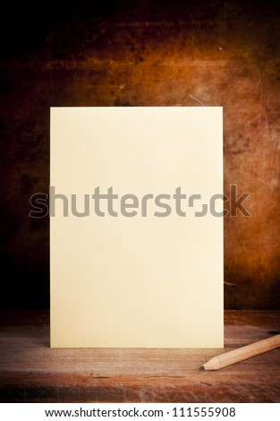 Vintage envelope background with pencil on a dark grunge background in shallow focus - stock photo