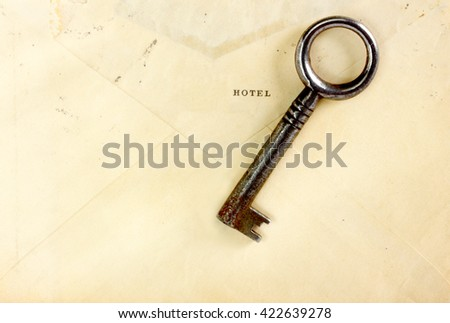Vintage envelope circa 1918 and skeleton key - stock photo