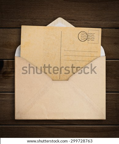 Vintage envelope with paper on table.