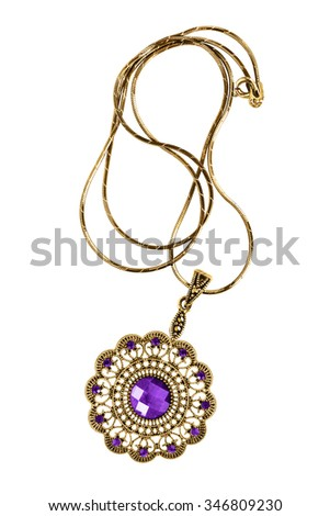 Vintage ethnic amethyst medallion isolated over white