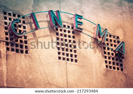 Vintage Facade of old cinema in Bucharest Romania, with cinema written - stock photo