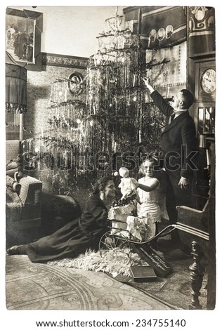 vintage family portrait of parents and child with christmas tree. antique picture with original film grain and blur. black and white photo - stock photo