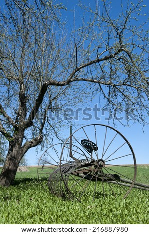 Vintage farm equipment, horse drawn rake  - stock photo