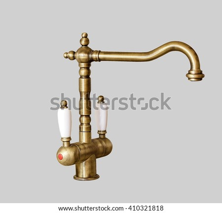 vintage faucet. isolated on light gray background