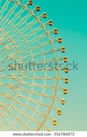 Vintage ferris wheel in the park at Japan - Vintage filter effect