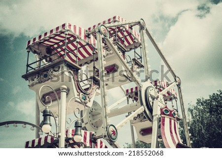 vintage ferris wheel, with added grain and vintage effect - stock photo