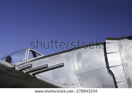 Vintage fighter guns cockpit and fuselage - stock photo
