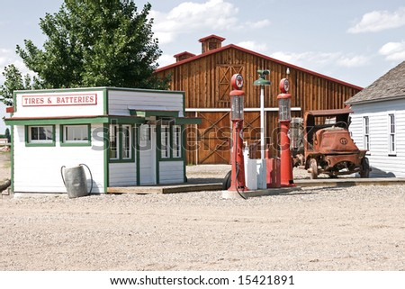 Vintage filling station with antique truck and other buildings at a museum