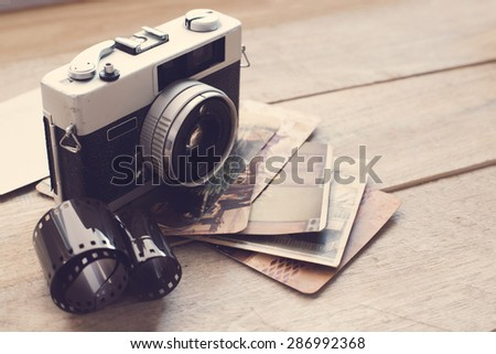 Vintage film camera on wood background with instagram retro filter effect  - stock photo