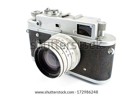 Vintage film photo camera isolated on white - stock photo