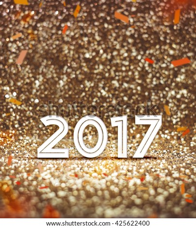 Vintage filter : happy new year 2017 year number with confetti at sparkling golden glitter background ,Holiday Greeting card,leave space for adding your content. - stock photo